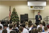 Mayor Gerry Scharfenberger speaking to students and parents at the Project Plus Graduation on Thursday, 12/14